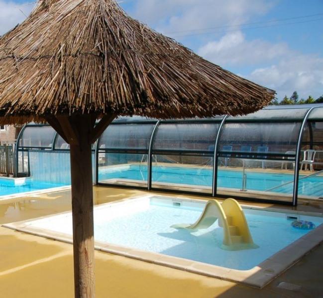 A 2kms des plages de Port Blanc, nous proposons sur notre camping avec piscine chauffée et Spa, une sélection de mobi...