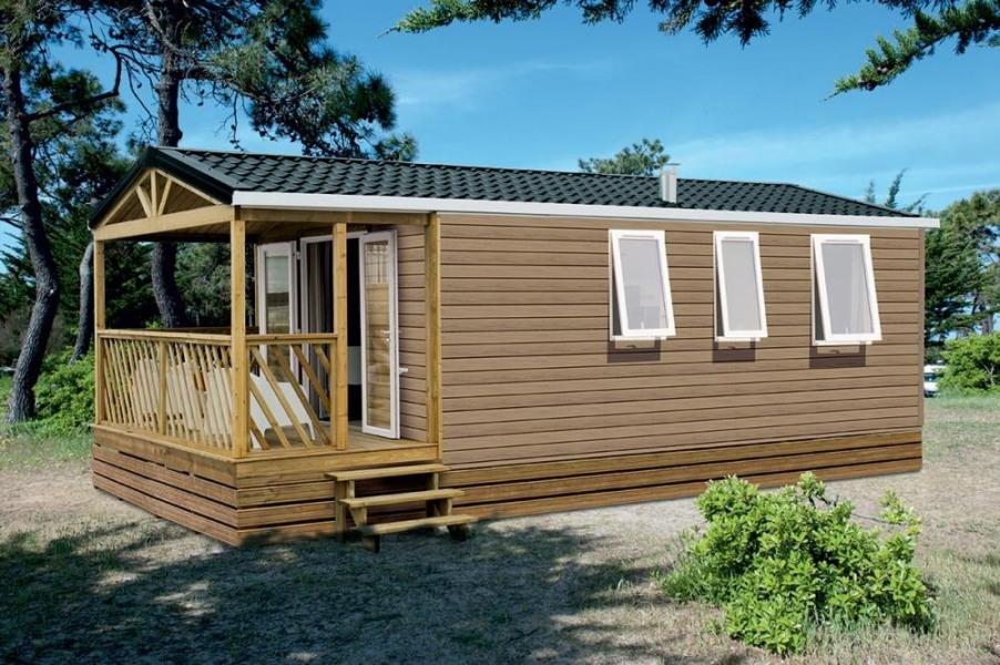 Au Camping La Prairie 4 étoiles à St Jean de Monts, cottage 27m² avec 2 chambres, pièce de vie spacieuse, terrasse en...
